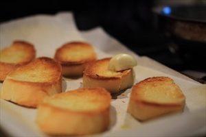 Rubbing Garlic on Crostini