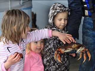 Kids after a day of Dungeness Crabbing