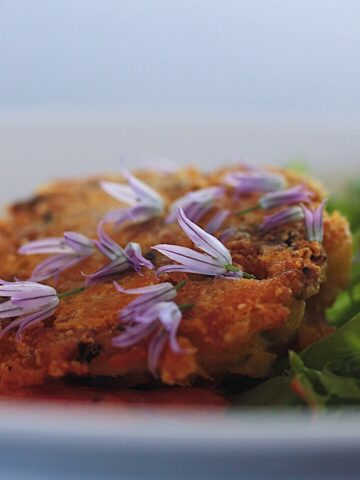 Dungeness Crab Cakes with Roasted Red Pepper and Chive Blossoms