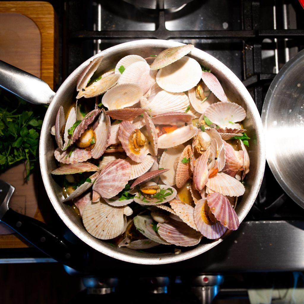 Add Scallops to the herb and wine broth for the vongole recipe