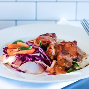 Colorful fresh coleslaw and roti with Peanut Sauce Baked Chicken