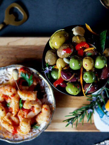 Warm marinated olives with orange, anise and garlic makes a stunning and easy appetizer