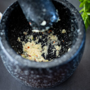 Puree salt and garlic together for dip recipe