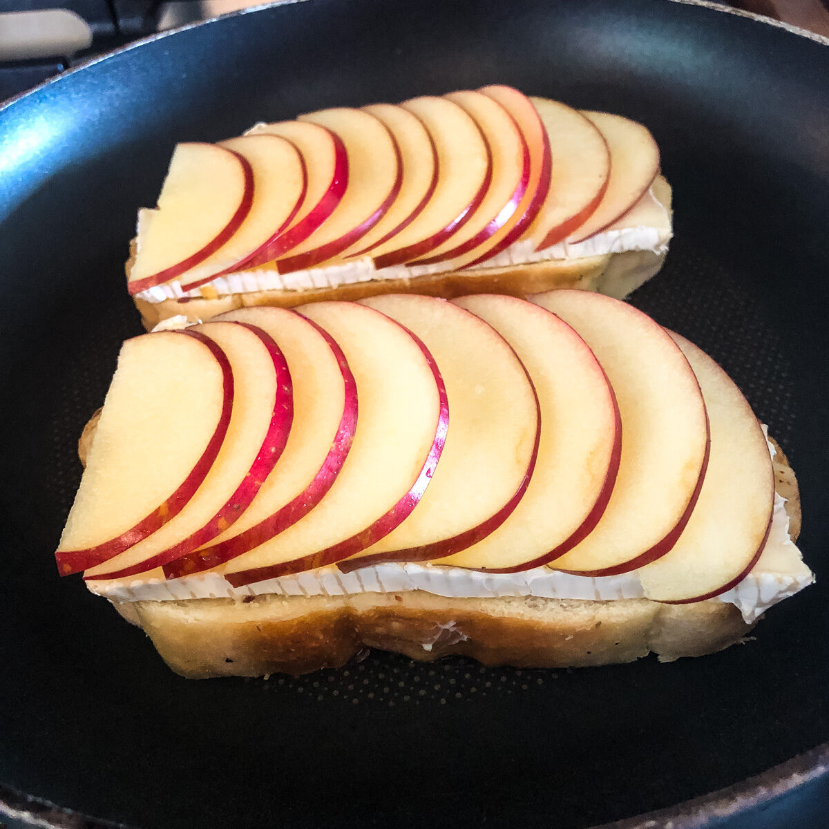 Thinly slice and fan out apples for apple brie grilled cheese