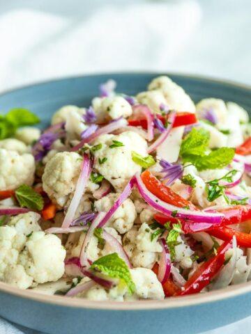 Mediterranean Cauliflower Salad in Blue Bowl