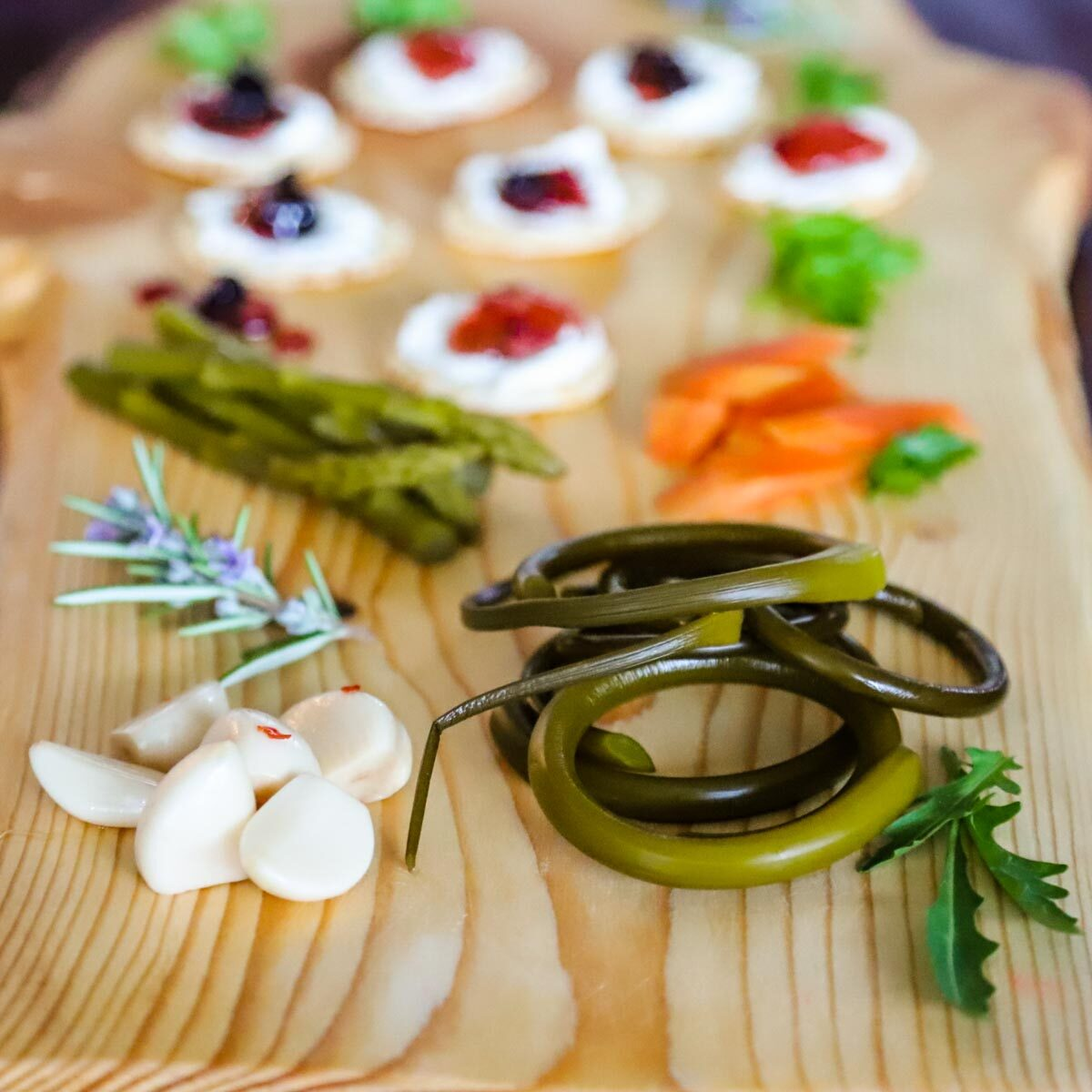 Pickled garlic scapes and other pickles and pepper jellies from Caties Hot Dilled Beans