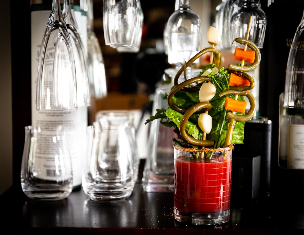 Garnish a Caesar cocktail with fermented or pickled garlic scapes